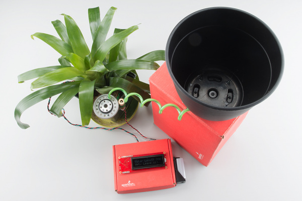 Soil moisture sensor with self watering system