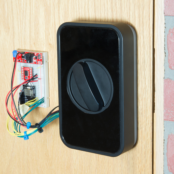 Lockitron and breadboard mounted on a door