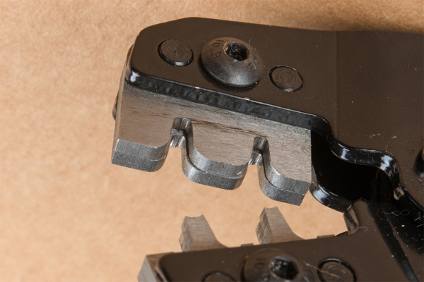 Close-Up of the Crimp Tool With Two Grooves and Die Recessed for Insulator Tab