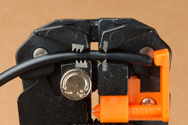 Insert Cable Between Self-Adjusting Wire Stripper's Jaws
