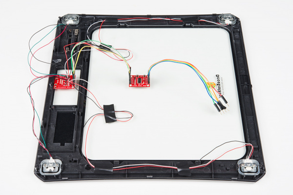 SparkFun's strain gauge load cell combinator board hooked up to a home scale, possible configuration for four disc load cells