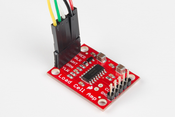 Strain gauge load cell hooked up to SparkFun's HX711 amplifier breakout board