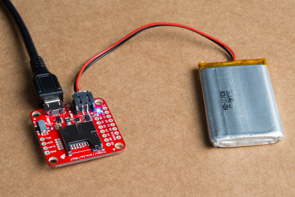 LiPo and USB plugged into and powering board
