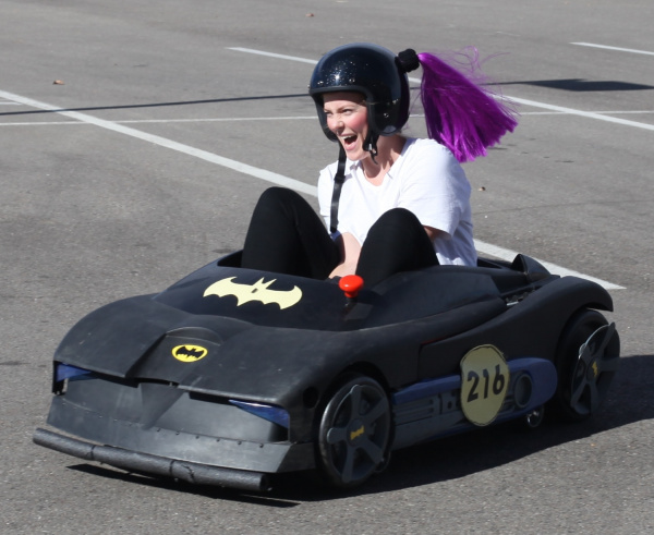 Smiling big in Batmobile