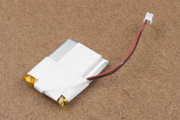 Electrical tape around the wires of a LiPo for strain relief