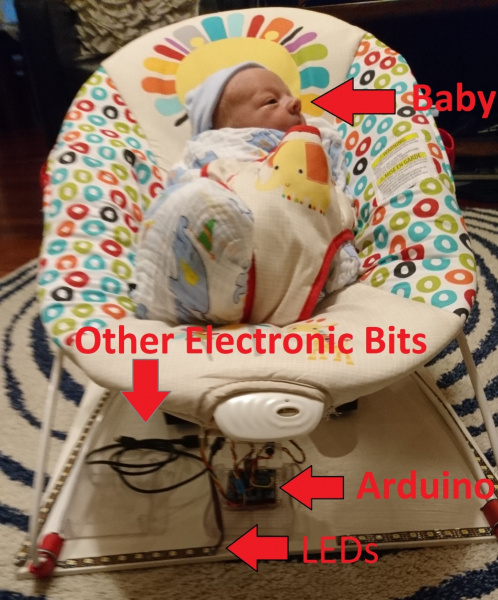 Baby in bouncy chair with Arduino