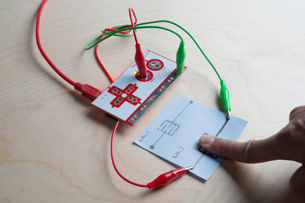 Pressing Down on the Buttons with the Makey Makey