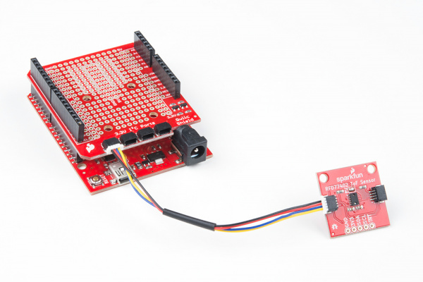 Qwiic Distance Sensor Connected to Qwiic Shield Stacked on RedBoard