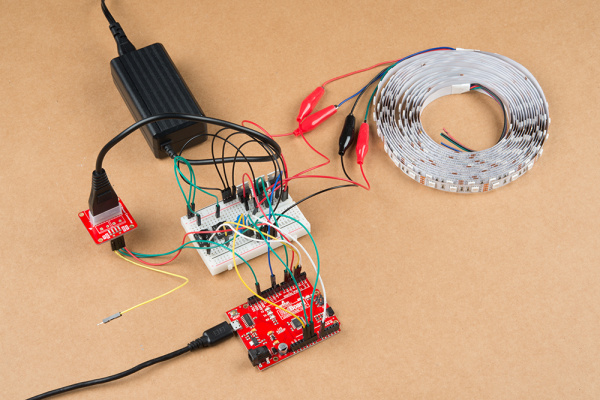 12V/5V power supply and a USB cable connected to an Arduino and the Non-Addressable RGB LED Strip