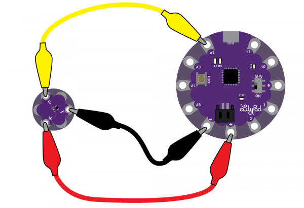 LilyPad Light Sensor clipped to a LilyPad USB with alligator clips