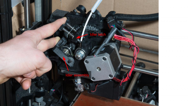 Opening the idler assembly to replace the filament in a LulzBot