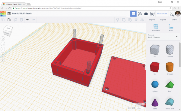 Click the Group button in Tinkercad to subtract a hole object from a solid object