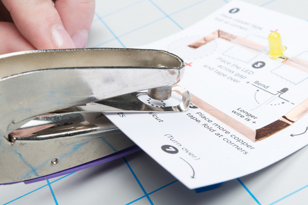 Using a hole punch on the template