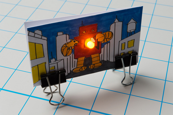 Using a second binder clip to create a standing artwork