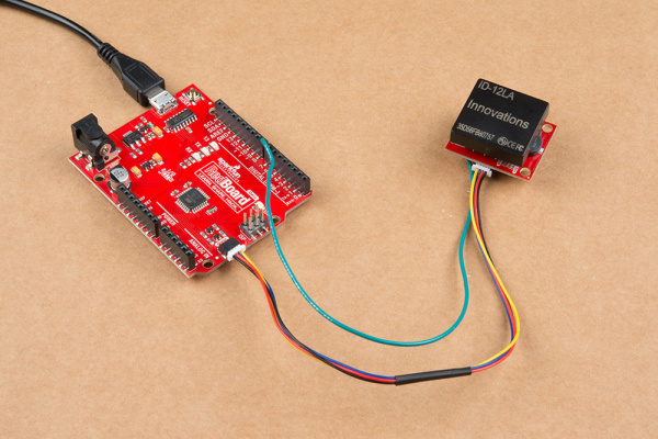 Here is an image of the Qwiic RFID module connected to the Redboard Edge via a Qwiic cable with an additional wire connecting the product's interrupt with pin 8 on the Redboard.