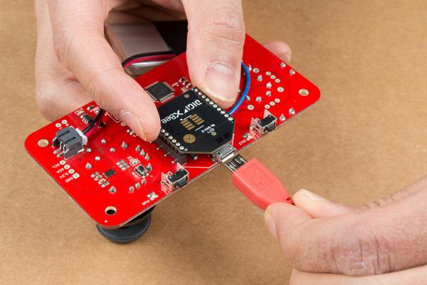 micro-B USB Cable inserting into Wireless Joystick