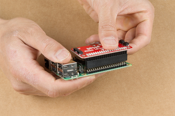 Qwiic pHat Being Inserted into Raspberry Pi