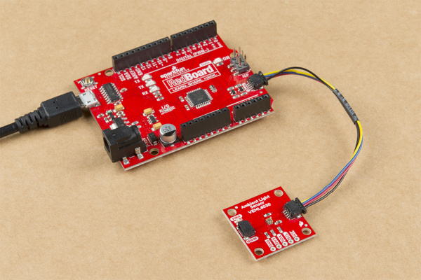 This image shows a picture of the SparkFun Ambient Light Sensor connected to a Redboard Qwiic by a Qwiic cable.